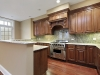 Kitchen with granite backsplash